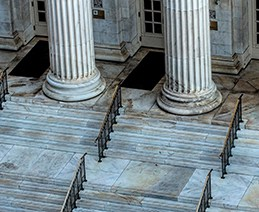 government building with columns and marble stairs.